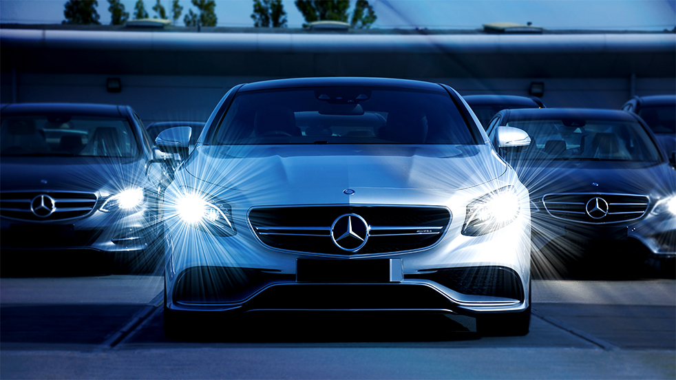 Mercedes group cars with lights in blue setup